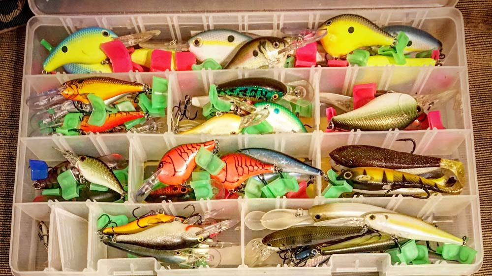 Tackle box tray with a variety of freshwater lures.