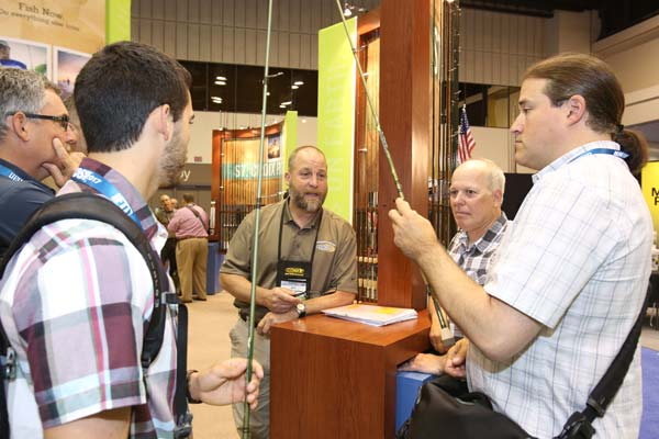 ICAST attendees examine the latest rods from St. Croix Rods.