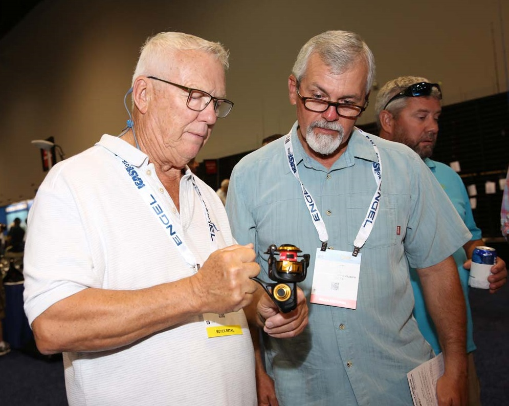 Buyers and Media review a new fishing reel at ICAST