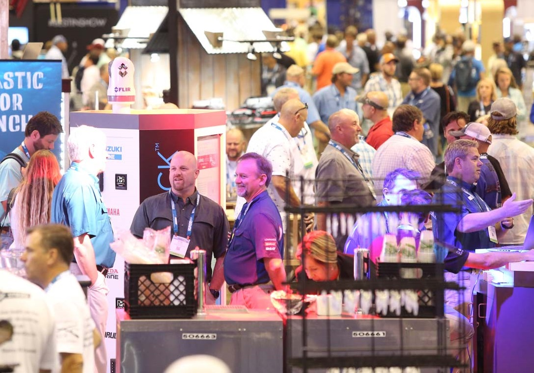 View of the show floor at ICAST showing exhibitors and attendees interacting