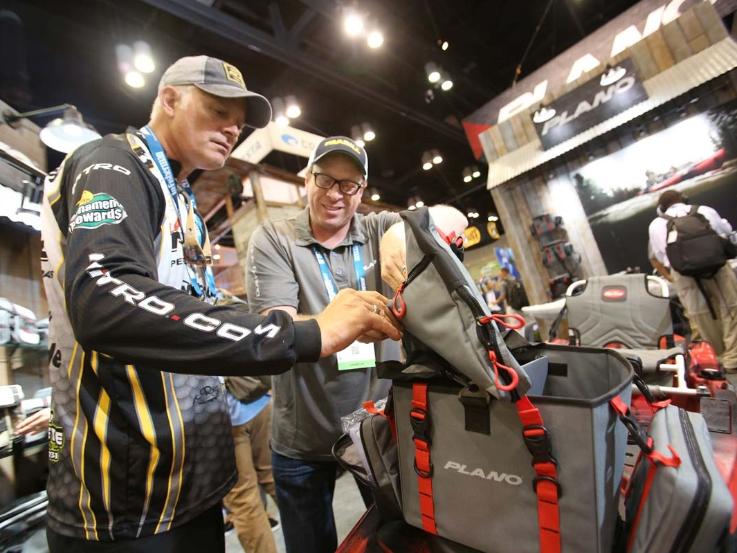 ICAST attendee examines a tackle bag in the Plano booth
