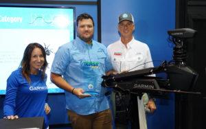 (L to R): Garmin's Carly Hysell and David Dunn are congratulated by Glenn Hughes, ASA President